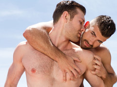 Good looking gay couple having lusty sex outdoors on a terrace